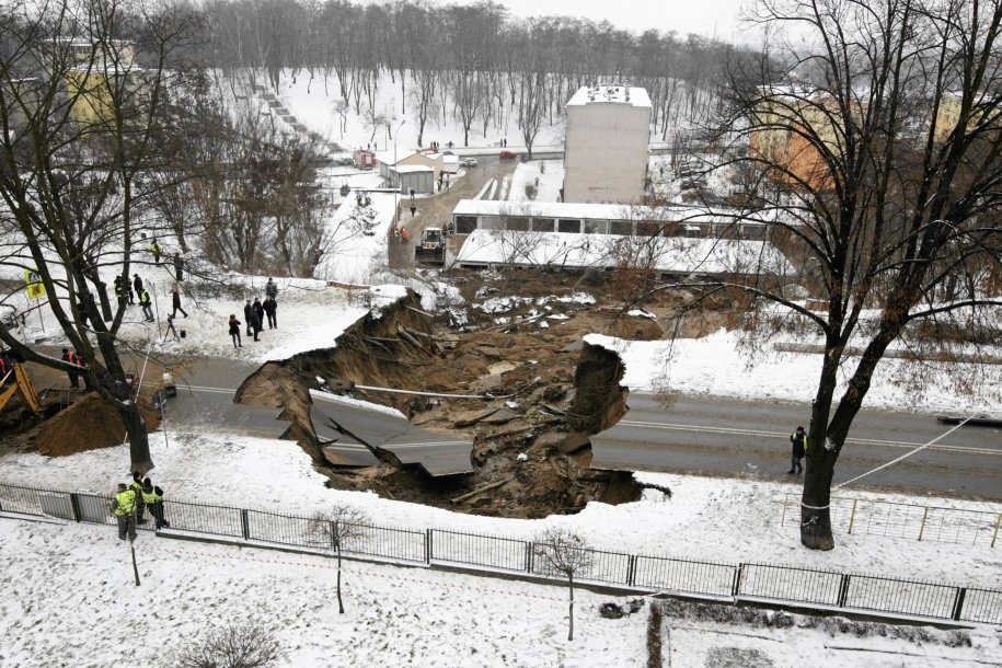 one-night-in-december-2012-a-sinkhole-measuring-33-feet-deep-and-164-feet-wide-developed-under-this-section-of-road-in-southern-poland